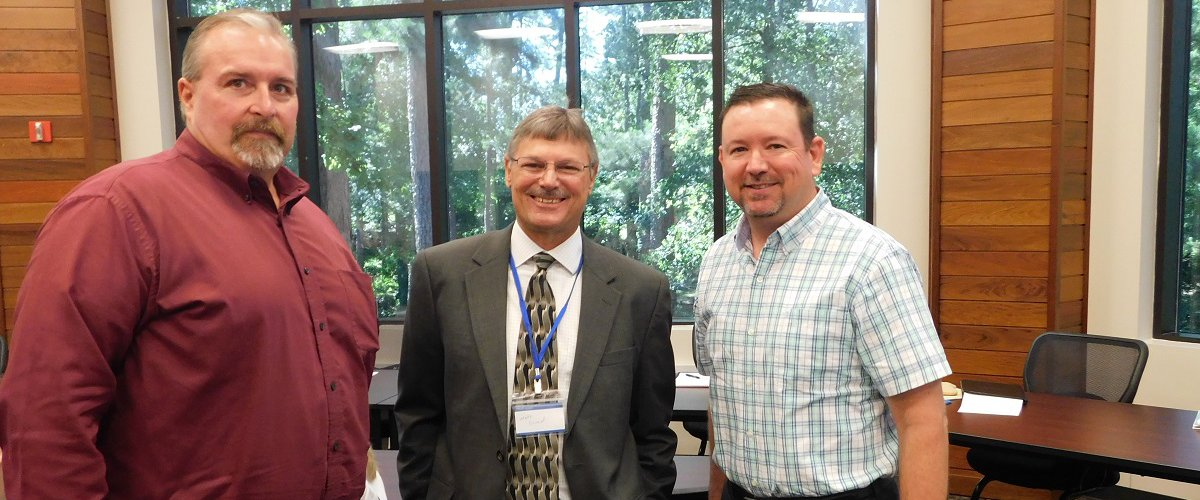 Partnering for Tomorrow's Workforce. Recent workshop for area school district leaders highlighted strategies to link workforce and education to prepare students for college or career in industry. : Pictured are Jeff Eichman, CTE Director at Coldspring-Oakhurst ISD, Workforce Solutions Executive Director Mark Durand, and P.T. Walters, CTE Director at Hudson ISD.