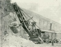 Steam shovel and working crew shown as cut for the railroad was made. The man seated on the platform is Hilton Beer, fireman, and the next man to the right is Levi W. Lane, engineer