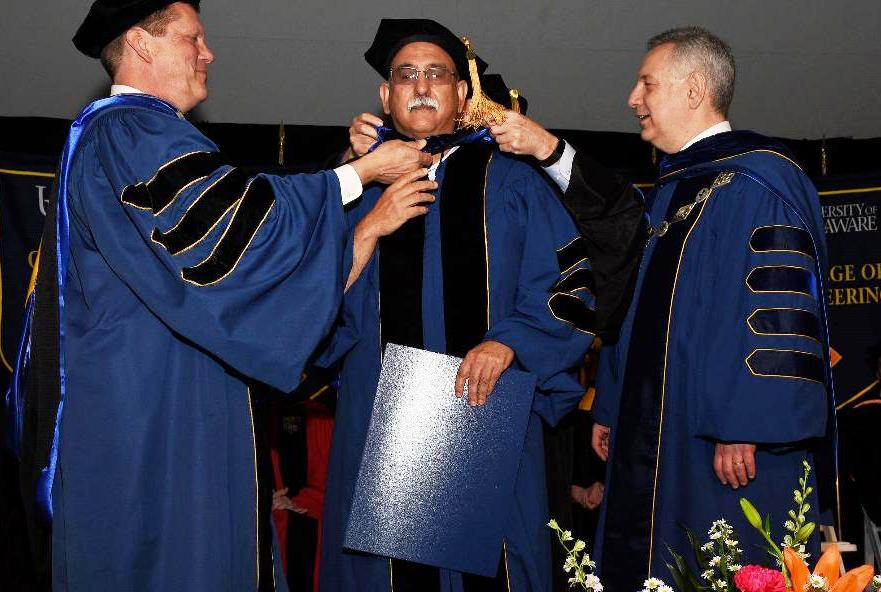 Tony DePrima being awarded PhD at University of Delaware hooding ceremony