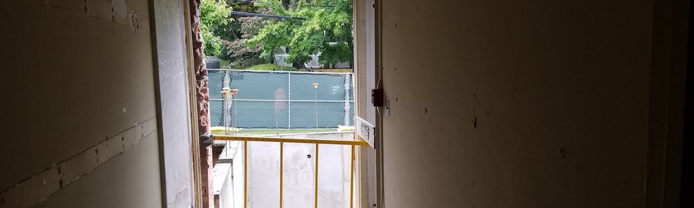 : New opening in existing exterior wall cut to connect the new addition